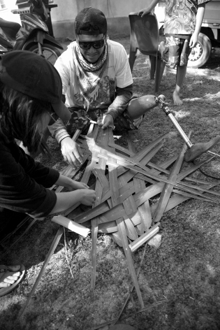 Our web content creator learning to weave. Photo by Jessie Lee Cederblom